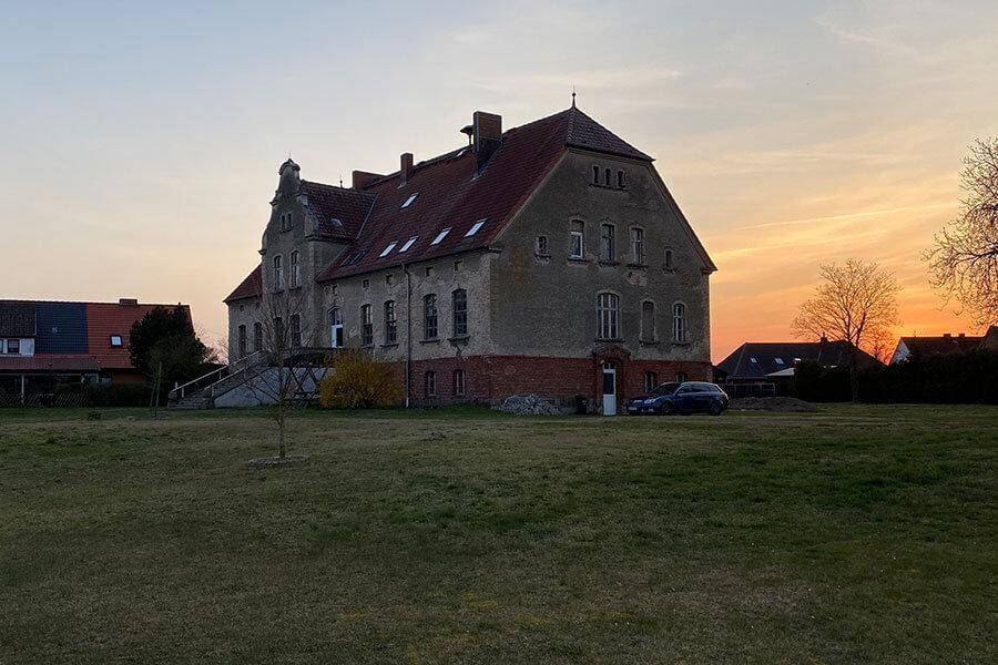 Schönwalde - Gutshaus im Sonnenuntergang